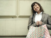 Happy woman with shopping bags in the city, steadicam shot NTSC Stock Footage