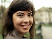 Attractive smiling happy woman in the city, steadicam shot NTSC Stock Footage