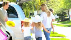 Young Family Packing Car for Trip to Beach  Stock Footage