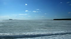 Clouds floating above the frozen sea in spring Stock Footage
