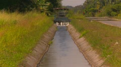 Agriculture, irrigation canal long shot Stock Footage