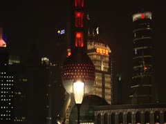 Nighttime on the Bund - tilt up Pearl Tower Stock Footage