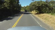 POV drive plate along forest lined highway, Panama Stock Footage