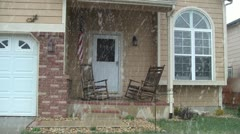 Front porch in snowstorm Stock Footage