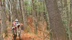 Motocross rider with camcorder on helmet Stock Footage