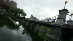 Public garden bridge dutch angle Stock Footage