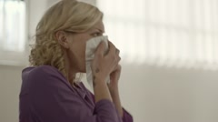 Allergy and health problems for young woman sneezing at work - stock footage