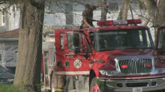 Stock Footage - Fireman loading older fire truck on the scene Stock Footage