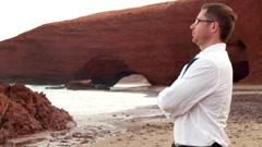 Businessman relaxing on beautiful Legzira beach Stock Footage