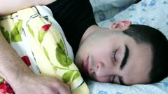 Young Man Waking Up From Bed Stock Footage