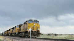 Freight Train under Cloudy Skies Stock Footage
