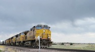Stock Video Footage of Freight Train under Cloudy Skies