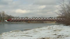 Santiago Calatrava designed Peace bridge, Calgary wide shot Stock Footage