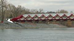 Santiago Calatrava designed Peace bridge, Calgary medium shot Stock Footage