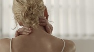 Young woman massaging stiff neck for health problems Stock Footage
