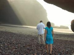 Couple meeting on Legzira beach, dolly shot Stock Footage