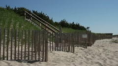 P5C25 Hamptons Dune with Fence (from Tilt down) - stock footage