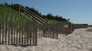 P5C25 Hamptons Dune with Fence (from Tilt down) Stock Footage