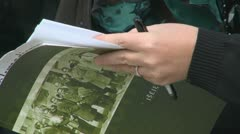 Hands opening the book - stock footage
