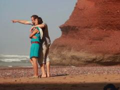 Young couple sightseeing on Legzira beach, steadicam shot Stock Footage