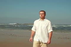Man walking on the beach, steadicam shot - stock footage