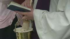 Priest hands with Holy book Stock Footage