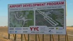 Calgary, YYC airport development program billboard Stock Footage