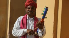 Indian Man Plays Stringed Instrument in Jaipur - stock footage