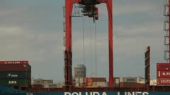 Container lifted by crane in port from ship Stock Footage