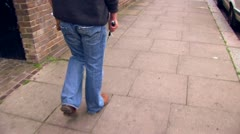 Walking with aid of a blind man. (Steady-Cam) Stock Footage