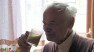 Stock Video Footage of senior drinking coffee