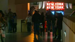 Las Vegas, people silhoutted walking to NYNY casino Las Vegas Stock Footage