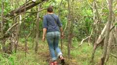 Woman Hiking in the Jungle Stock Footage