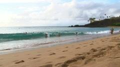 Kids Catching the Hawaiian Surf Stock Footage