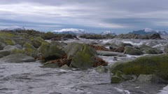 Rocky shoreline in Norway. Slow motion low angle Stock Footage