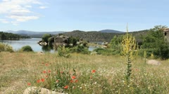 Spain Castile Valle de Iruelas lake and poppies 2 Stock Footage