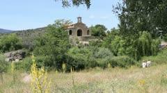 Spain Castile Valle de Iruelas chapel and hikers Stock Footage