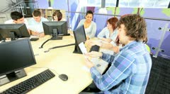 Team of classmates focus IT application online   Stock Footage