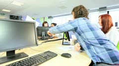 Group of young students learning graduate tests in class  - stock footage