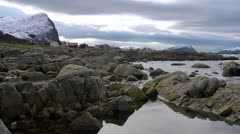 Rocky shoreline. Slow pan right to the Island of Runde in Norway Stock Footage