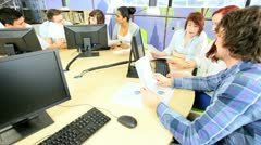 Teamwork of students focus online in college library  - stock footage