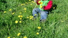 Small girl  on meadow with dandelion Stock Footage
