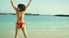 Young woman in red bikini jumping in the beach, slow motion HD Stock Footage