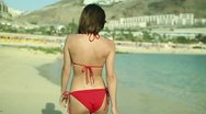 Stock Video Footage of Woman in red bikini walking on the beach, slow motion, steadicam  HD