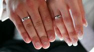 Two arms and two wedding rings Stock Footage