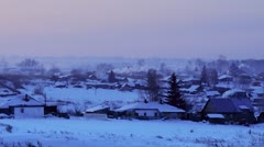 Winter village at early morning - stock footage