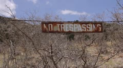 No Trespassing Sign on Barbed Wire Fence - Medium - stock footage