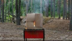 Burning carton box, first part Stock Footage