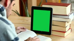 Boy studying with tablet (with green screen) Stock Footage