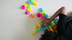 Time Lapse of Young Girl Playing with Building Blocks - stock footage